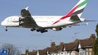 An Emirates Airbus A380 aircraft comes into lane at Heathrow Airport