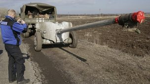 An OSCE observer takes a picture of Ukrainian artillery near Soledar, in the Donetsk region, 27 February