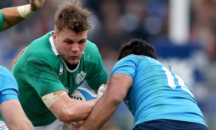 Jordi Murphy attempts to barge past Italy's Kelly Haimona in Rome