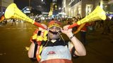 A German fan celebrates with vuvuzelas in Berlin after Germany won the 2014 World Cup final