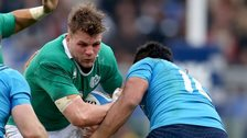 Jordi Murphy attempts to barge past Italy's Kelly Haimona in Rome earlier this month