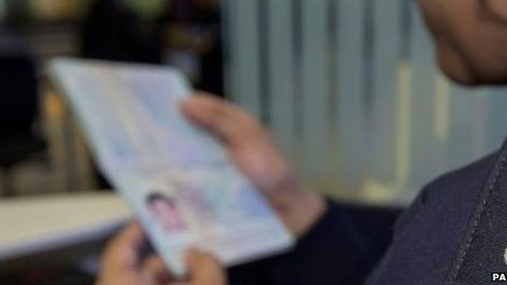 Person looking at their passport