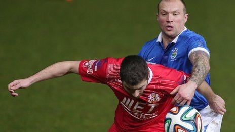 Warren Feeney challenges Chris Ramsey in Portadown's 2-1 win at Windsor Park