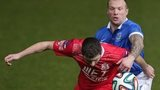 Warren Feeney challenges Chris Ramsey in Portadown's 2-1 win at Windsor Park