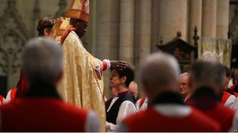 The Rev Libby Lane kneels before the Archbishop of York