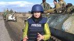 BBC reporter Anastasia Gribanova standing in front of Ukrainian army vehicle in Artemivsk, eastern Ukraine
