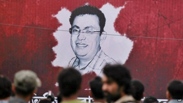 Poster displaying a portrait of Avijit Roy in Dhaka (27 February 2015)