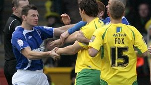 Ipswich and Norwich players tussle
