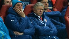 Arsenal's manager Arsene Wenger (front) watches his side in action against Monaco