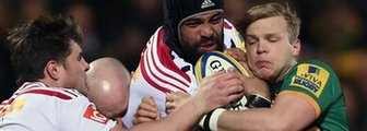 Northampton and Harlequins players battle for the ball