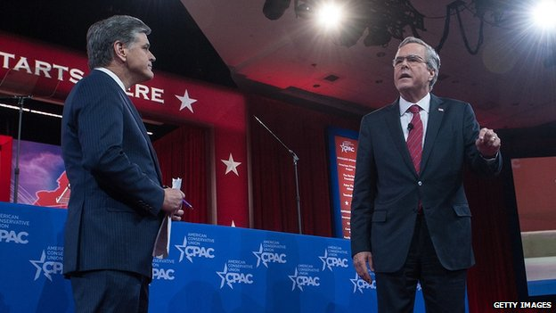 Fox News host Sean Hannity and Jeb Bush take the stage at CPAC.
