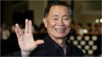 George Takei making the Live Long and Prosper symbol