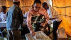 A resident casts her ballot for the parliamentary elections at a voting station in Lesotho
