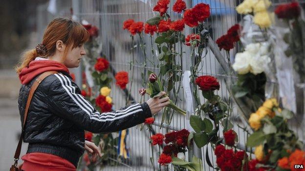 Flowers are left outside the Russian embassy in the Ukrainian capital, Kiev, 28 Feb