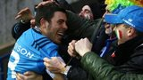 Italy scrum-half Edoardo Gori celebrates with fans