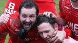 Portadown midfielder Tim Mouncey congratulates goalscorer Gary Twigg