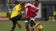 Lucas Akins of Burton Albion collides with David Tutonda