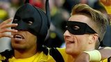 Borussia Dortmund players Pierre-Emerick Aubameyang and Marco Reus celebrate their team's first goal against Schalke