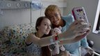 "Chile""s President Michelle Bachelet, right, poses for a selfie with Valentina Maureira, who suffered of cystic fibrosis at a hospital in Santiago, Chile, Saturday, Feb. 28, 2015."