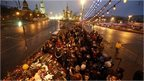 People gather at the site where Boris Nemtsov was recently murdered, in central Moscow