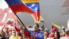 "Venezuela""s President Nicolas Maduro (R) greets supporters during a rally to commemorate the 26th anniversary of the social uprising known as ""Caracazo"", which Venezuela""s late President Hugo Chavez said marked the start of his revolution, in this Caracas"
