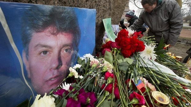 People lay flowers in memory of Boris Nemtsov in St Petersburg, Russia - 28 February 2015