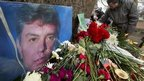 People lay flowers in memory of Boris Nemtsov in St Petersburg, Russia - 28 February 2015