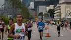 "Competitors run in Hong Kong""s first inner city ultra marathon on March 1, 2015"