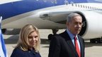 Israeli Prime Minister Benjamin Netanyahu with his wife Sarah at Ben Gurion airport - 1 March