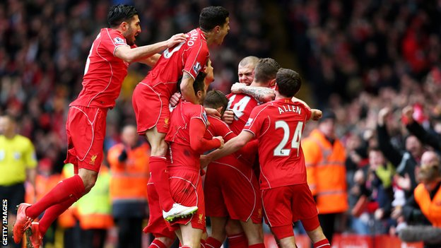 Liverpool celebrate scoring against Manchester City