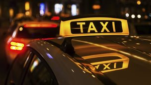 A taxi at night