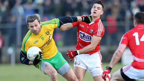 Donegal's Christy Toye fends off Cork's Tomas Clancy at Ballyshannon