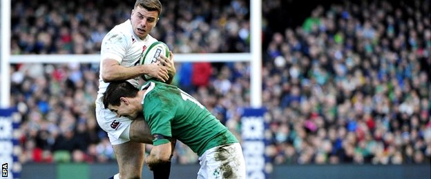 Ireland's Jonathan Sexton (R) tackles England's George Ford