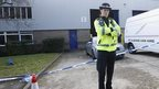 Police outside a warehouse on the River Ray industrial estate in Swindon, Wiltshire, where 4 police officers were injured after a 9-hour stand-off with revellers at an illegal rave