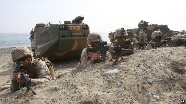 In this 32 March 2014 photo, US Marines take a position during the US-South Korea joint landing exercises as part of the Foal Eagle military exercises in Pohang, South Korea
