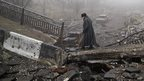 An elderly woman walks across a destroyed bridge near the airport in Donetsk, Ukraine - 1 March 2015