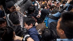 Police use pepper spray to disperse protestors during a clash at a rally against parallel-goods trading at Yuen Long district on March 1, 2015 in Hong Kong