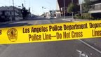 Police tape stretched across a street in Los Angles - 29 December 2014