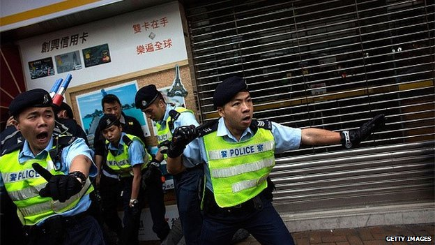 Police and protestors clash in Yuen Long during a rally against parallel-goods trading on March 1, 2015 in Hong Kong, Hong Kong
