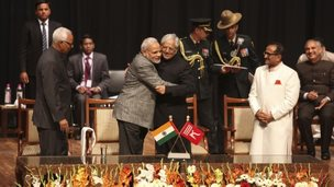 PM Narendra Modi, center left, greets Peoples Democratic Party Mufti Mohammed Sayeed after the later was sworn in as the chief minister of Jammu and Kashmir state on Sunday, March 1, 2015.