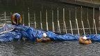 Men draining canal