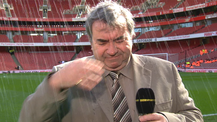 Jonathan Pearce gets soaked by a sprinkler