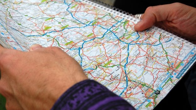 Hitchhiker holding a road map