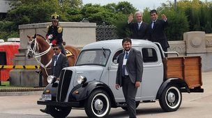 Newly sworn-in Uruguayan President Tabare Vazquez (left) and his Vice-President Raul Sendic wave atop a Fordson 1951 after leaving the Congress on his way to Plaza Independencia in Montevideo on 1 March, 2015.
