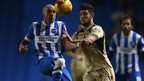 Brighton defender Bruno battles Leeds' Alex Mowatt for the ball