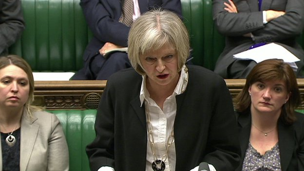 Home Secretary Theresa May defending the government's counter-terrorism policies in the House of Commons