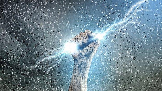 Hand grasping lightning