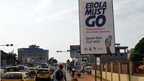 "A picture taken on February 23, 2015 shows an Ebola campaign banner with the new slogan ""Ebola Must GO"" in Liberia"