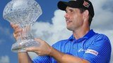Padraig Harrington celebrates with trophy