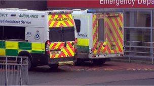 Ambulances wait outside an emergency department